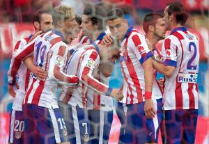MADRID, SPAIN - APRIL 25: Antoine Griezmann (4R) of Atletico de Madrid celebrates scoring their second goal with team mates Juan Francisco Torres alias Juanfran (L), Fernando Torres (2ndL), Tiago Mendes (4L), Jose Maria Gimenez (3R), Gabi Fernandez (2R) and Diego Godin (R) during the La Liga match between Club Atletico de Madrid and Elche FC at Vicente Calderon Stadium on April 25, 2015 in Madrid, Spain.  (Photo by Gonzalo Arroyo Moreno/Getty Images)